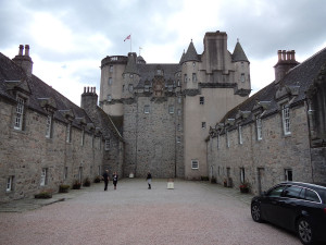 Castle Fraser courtyard. Easy to see the original central keep (with filled high entrance) and the later additions.